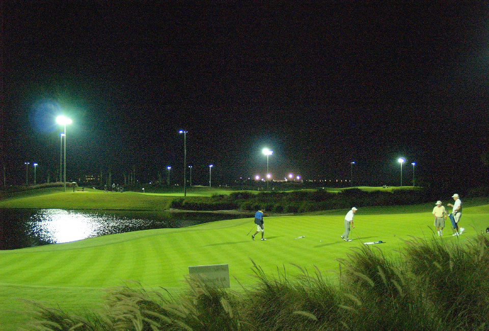 Golfers use the Duran Golf Club course at night