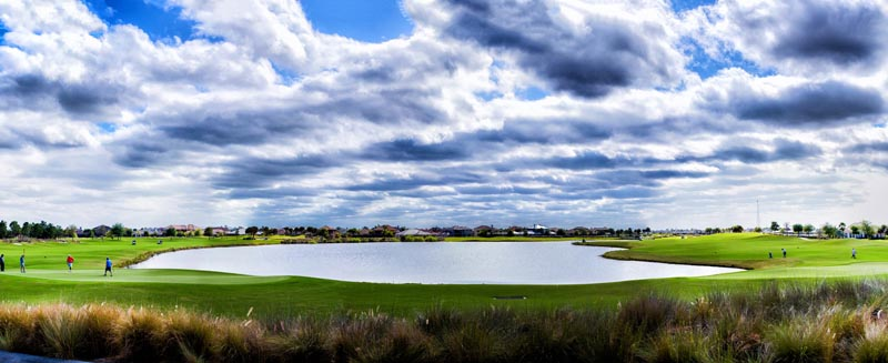 An expansive pond on the course at Duran Golf Club