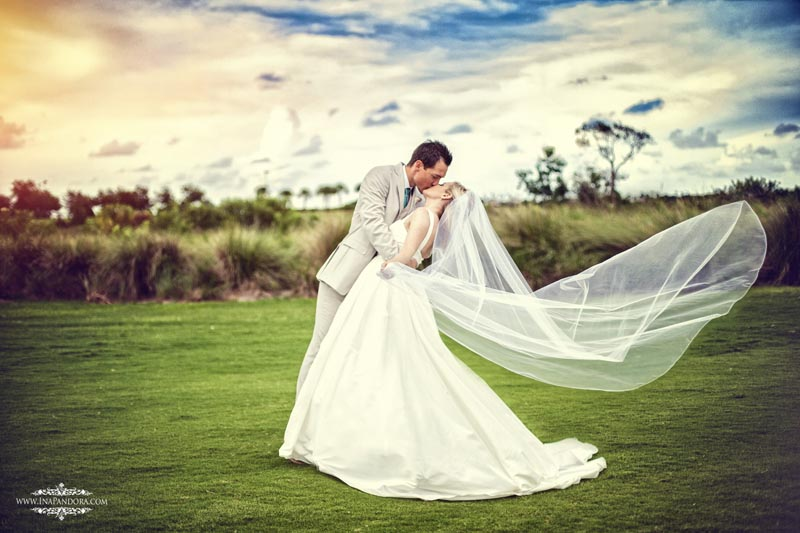 A newlywed couple embraces on their wedding day at Duran Golf Club